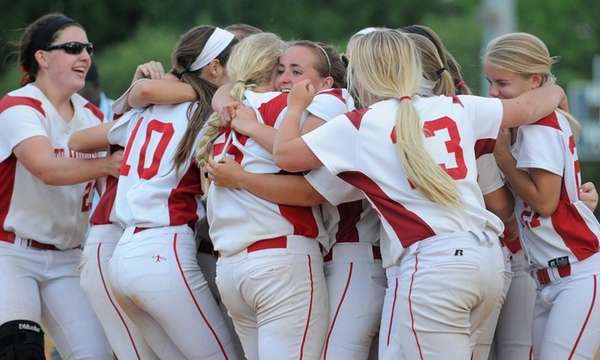 Center Moriches teammates celebrate after their 13-6 win