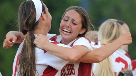 Center Moriches shortstop Cierra Smith, right, and 3B