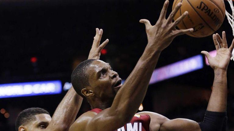Miami Heat center Chris Bosh grabs a rebound