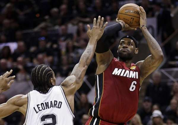 Miami Heat forward LeBron James shoots over San
