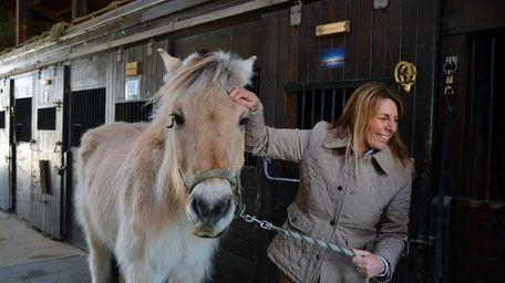 Lisa Gatti, executive director of Pal-O-Mine, an equine