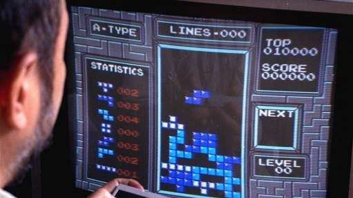 Tetris is shown as played on the Nintendo