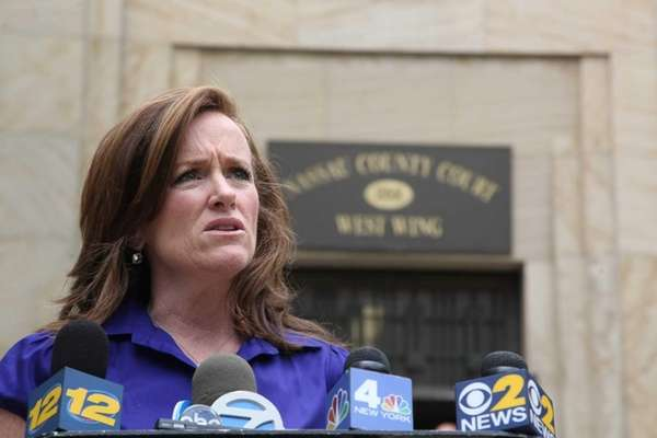 Nassau County District Attorney Kathleen Rice speaks outside