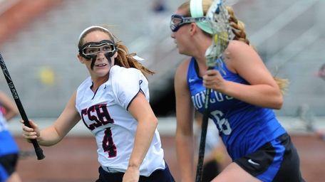 Cold Spring Harbor midfielder Alicia Roy defends Bronxville