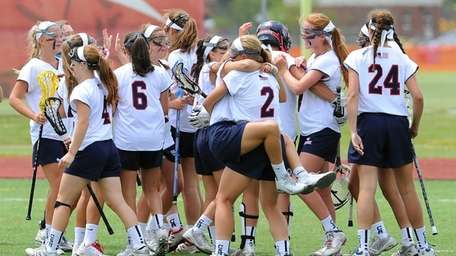 Cold Spring Harbor players celebrate following the game