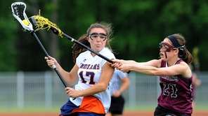 Manhasset defender Jackie D'Alleva controls the ball against