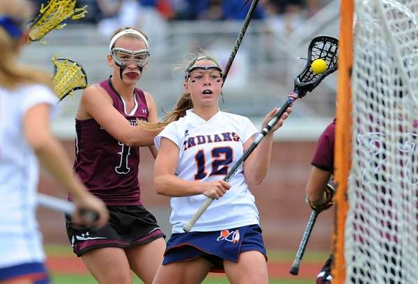 Manhasset attacker Lindsey Ronbeck dodges to the goal