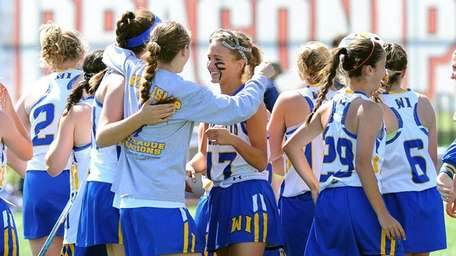 West Islip players celebrate following the game against