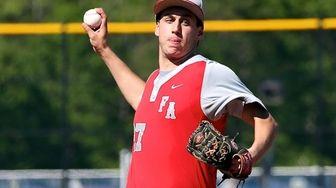 Friends Academy starting pitcher Matt Feinstein delivers a
