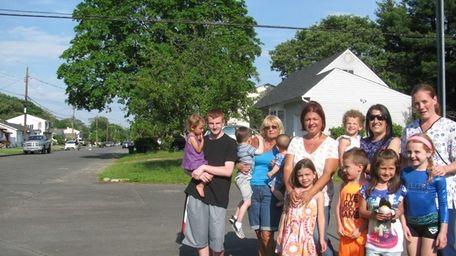 Jennifer Garcia, center, and neighbors on Silver Street