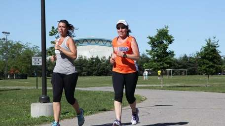 Runners enjoy the nice weather in Eisenhower Park,