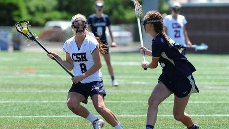 Cold Spring Harbor's Brooke Jensen dodges to the