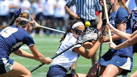 Cold Spring Harbor midfielder Holly Logan gets checked