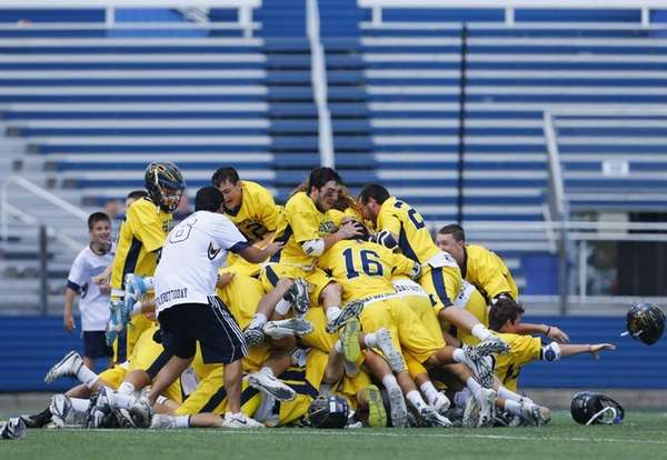 The Massapequa Chiefs celebrate after defeating Fayetteville-Manlius to