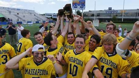 The Massapequa Chiefs celebrate after defeating the Fayetteville-Manlius