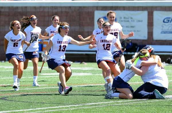 Manhasset players celebrate following the game against Victor