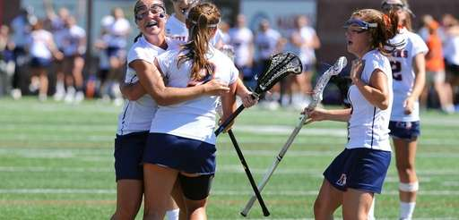 Manhasset players celebrate a goal against Victor during