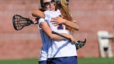 Manhasset midfielder Julia Glynn and attacker Lindsey Ronbeck
