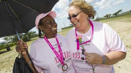 Sue Ifill of Amityville, left, a breast cancer