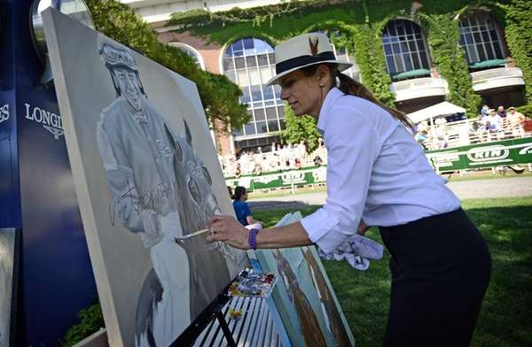 Artist Susan Sommer-Luarca paints in the paddock at