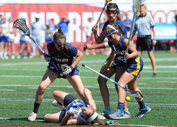 West Islip midfielder Vanessa Costantino loses control of