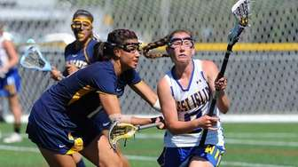 West Islip midfielder Lindsay Darrell controls the ball