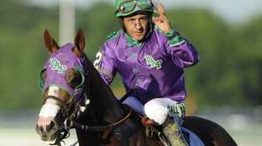 California Chrome, ridden by jockey Victor Espinoza, after