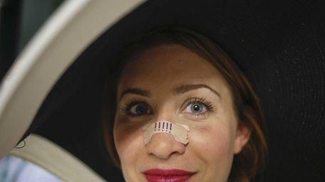 Shannon Flannigan of Brooklyn wears nasal strips at