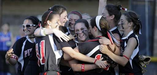 Pierson/Bridgehampton players surround starting pitcher Samantha Duchemin after