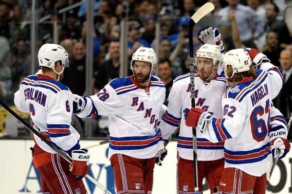 Ryan McDonagh of the Rangers celebrates with teammates