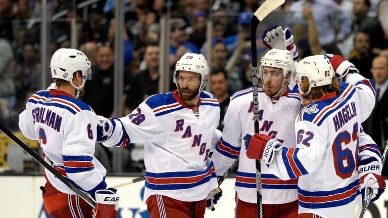 Ryan McDonagh of the Rangers celebrates with teammates