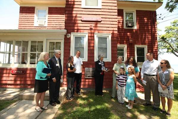 Ellen Glasser, center, president of the Society of Former Agents to the FBI, speaks during a dedication ceremony for the Benson House in Wading River Saturday, June 7, 2014. (Credit: Barry Sloan)