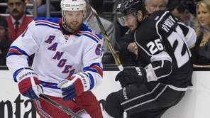 Rangers left wing Rick Nash battles Los Angeles