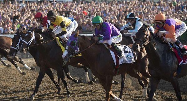 Losing jockey Victor Espinoza riding California Chrome at