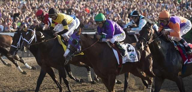 Losing jockey Victor Espinoza riding California Chrome at