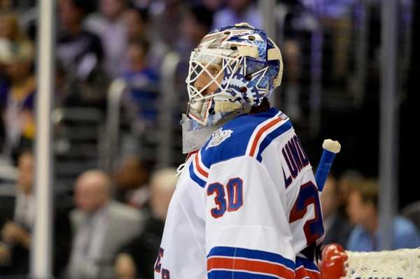 Henrik Lundqvist of the Rangers looks on against