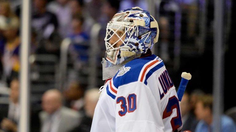 Henrik Lundqvist of the Rangers looks on against