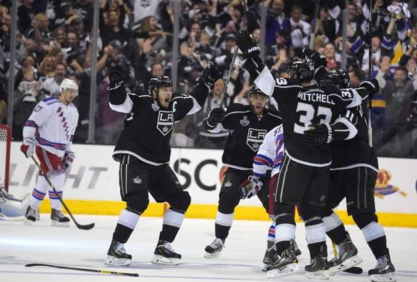 The Los Angeles Kings' Dustin Brown, second from