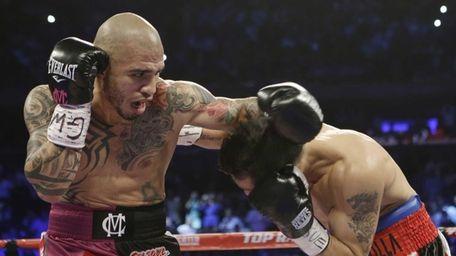 Miguel Cotto, left, of Puerto Rico, fights Sergio