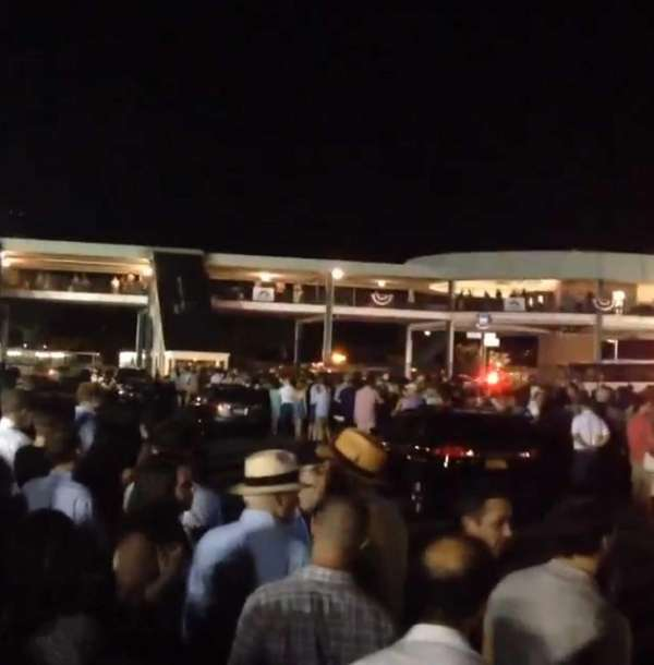 Patrons wait to board the train at the