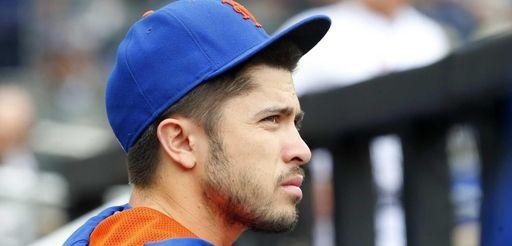 Travis d'Arnaud of the Mets looks on during