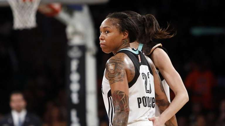 The Liberty's Cappie Pondexter reacts after scoring against
