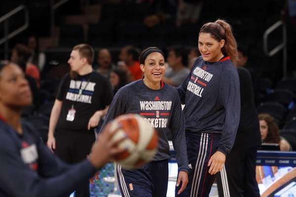 The Washington Mystics' Bria Hartley, center, warms up