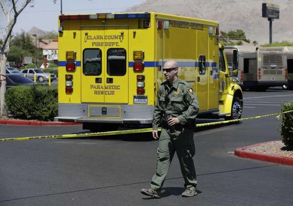 A Las Vegas Metropolitan Police officer walks near