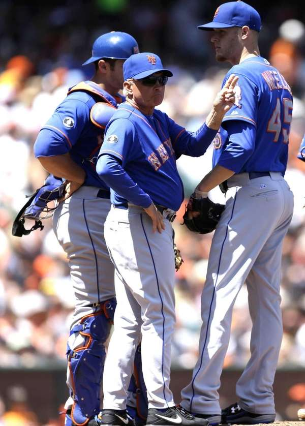 Mets manager Terry Collins, center, motions for lefthander