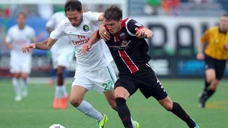 Cosmos forward Alessandro Noselli #22 and Ottawa Fury