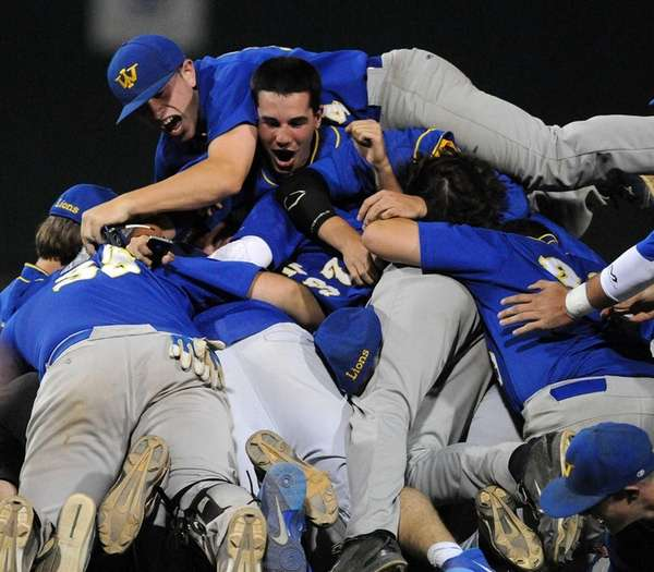 West Islip teammates mob one another in celebration