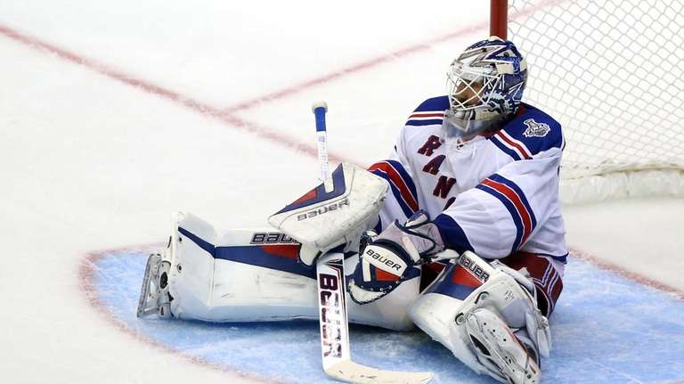 Henrik Lundqvist sits in the net after allowing