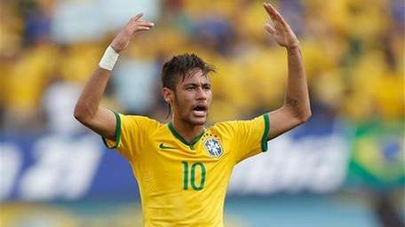 Brazil's Neymar celebrates after scoring against Panama during