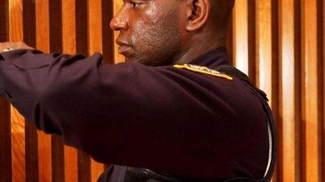 New York City Police Officer Jorbin Charles models